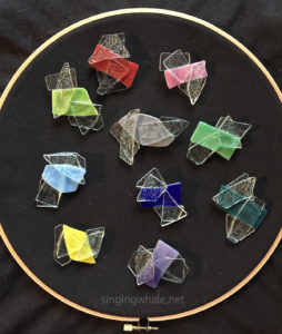 shattered glass ceiling pins in various colors